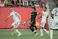 FOXBOROUGH, MA - AUGUST 4: Carlos Vela #10 of Los Angeles FC beats Antonio Mlinar Delamea #19 of New England Revolution and Edgar Castillo #8 of New England Revolution to the ball during a game between Los Angeles FC and New England Revolution at Gillette Stadium on August 3, 2019 in Foxborough, Massachusetts.