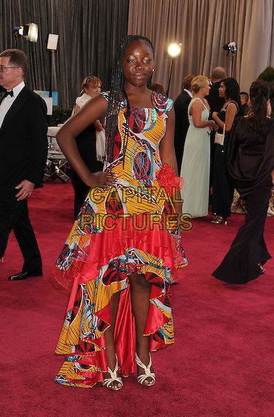 Rachel Mwanza.85th Annual Academy Awards held at the Dolby Theatre at Hollywood & Highland Center, Hollywood, California, USA..February 24th, 2013.oscars full length red yellow ruffle dress hand on hip.CAP/ROT/TM.©Tony Michaels/Roth Stock/Capital Pictures