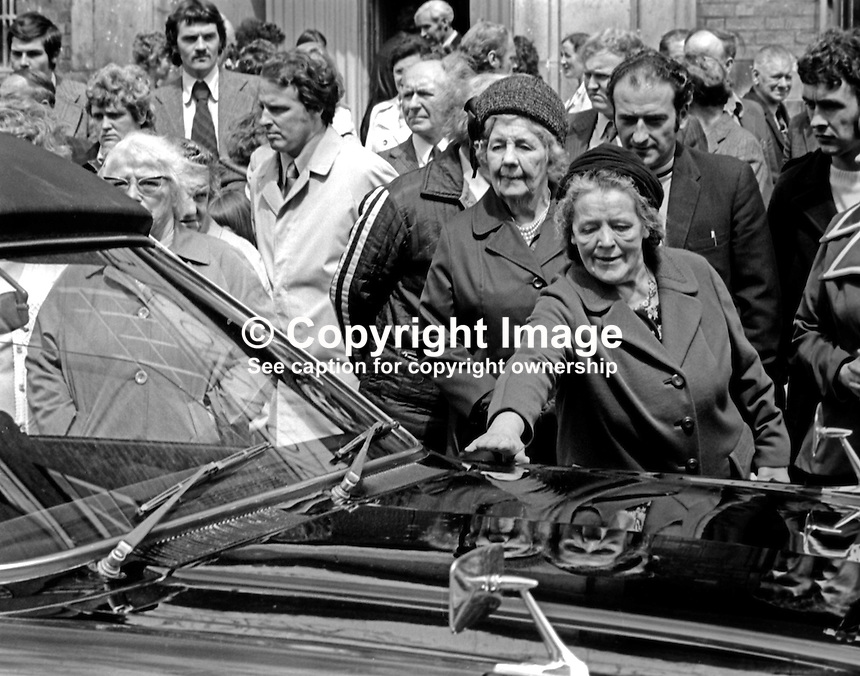 Funeral of N Ireland comedian James Young, 9th July 1974. As Belfast pays a fond farewell a favourite son a woman reaches out to touch the passing hearse. 197407090382f<br /> <br /> Copyright Image from Victor Patterson, 54 Dorchester Park, Belfast, UK, BT9 6RJ<br /> <br /> t1: +44 28 9066 1296<br /> t2: +44 28 9002 2446<br /> m: +44 7802 353836<br /> <br /> e1: victorpatterson@me.com<br /> e2: victorpatterson@gmail.com<br /> <br /> www.victorpatterson.com<br /> <br /> IMPORTANT: Please see my Terms and Conditions of Use at www.victorpatterson.com