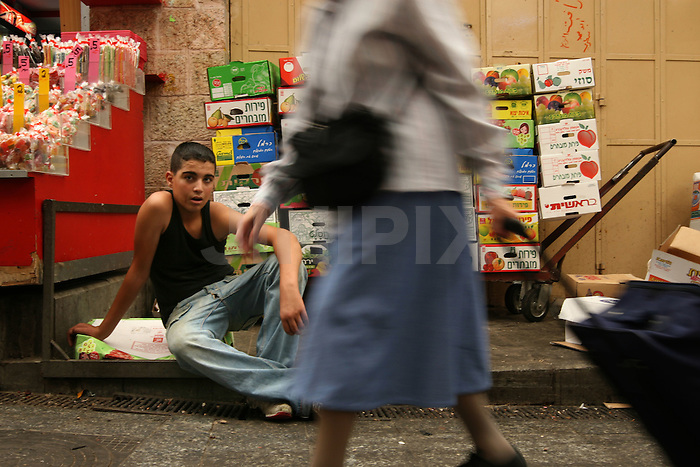 """Portrait of  Niahad, a 15 year-old Palestinian boy who works in the west-Jerusalem market of """"Machane Yehuda"""". July 9, 2008. .Photo by : Tess Scheflan/ JINI."""