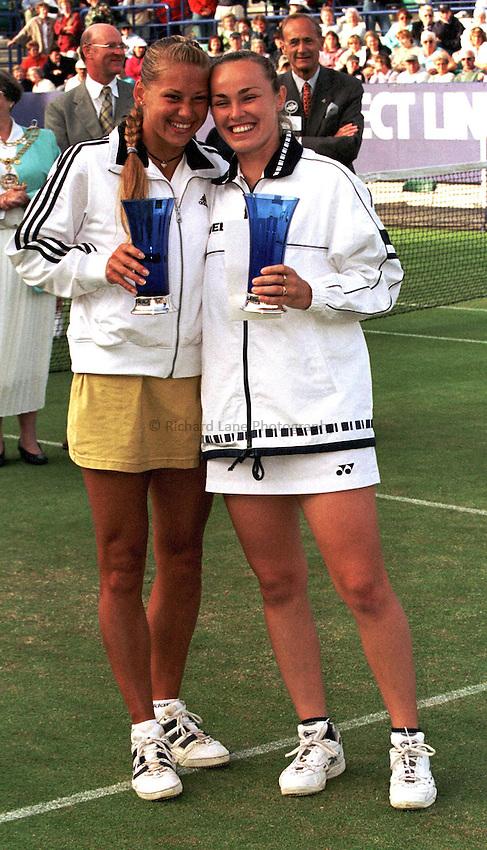 Photo. Richard Lane. .International Ladies Tennis, Eastbourne. 19/6/99..Martina Hingis and Anna Kourinkova with the Doubles Vase's.