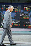 June 18, 2012, Tokyo, Japan - A businessman walks past the stock market board in downtown Tokyo displaying the different figures from stock exchanges all over the world. The Nikkei 225 climbed 151.70 points to 8,721.02 at Tokyo's 3pm closing. Greece's positive election vote helped ease fears that the country may fall out from the euro currency. (Photo by Christopher Jue/AFLO)