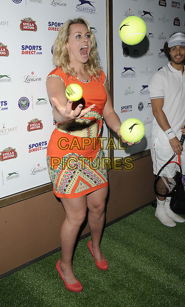 Chimene &quot;Chemmy&quot; Mary Alcott<br /> attended the Slazenger Wimbledon Party, Whisky Mist bar &amp; nightclub, Hertford St., London, England, UK, 27th June 2013.<br /> full length orange dress print shoes coral tennis ball  juggling balls yellow <br /> CAP/CAN<br /> &copy;Can Nguyen/Capital Pictures
