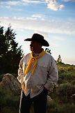 USA, Wyoming, Encampment, silhouette of a cowboy at sunset, Abara Ranch