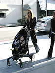March 1st 2012 ..Rachel Zoe pushing her baby Skyler in a stroller in Beverly Hills ..AbilityFilms@yahoo.com.805-427-3519.www.AbilityFilms.com