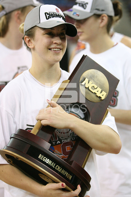 SACRAMENTO, CA - MARCH 29: JJ Hones holds the trophy after Stanford's 55-53 win over Xavier in the NCAA Women's Basketball Championship Elite Eight on March 29, 2010 at Arco Arena in Sacramento, California.