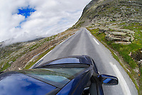 Car driving on mountain road, Norway