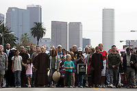 Los Angeles, Ca.- Several hundred people gathered Saturday morning at MacArthur Park in Los Angeles to join in a Peace Walk with vietnamese peacemaker, Thich Nhat Hanh (cq). The group walked around the park in silence after listening to the zen master, Scholar and auther speak about his efforts towards peace.  Anti-war Activist Cindy Sheehan was also a participant.