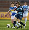 Morton's Ross Caldwell and Forfar's Gavin Malin challenge for the ball .