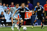 Brad Ring (black) San Jose Earthquakes moves ahead of, Omar Bravo Sporting KC...Sporting KC defeated San Jose Earthquakes 1-0 at LIVESTRONG Sporting Park, Kansas City ,Kansas,.. Sporting KC defeated San Jose Earthquakes 1-0 at