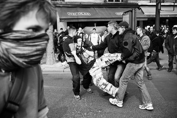 A young demonstrator is arrested by plain clothes police officers during a violent demonstration against college reform in Paris on April 10, 2008.