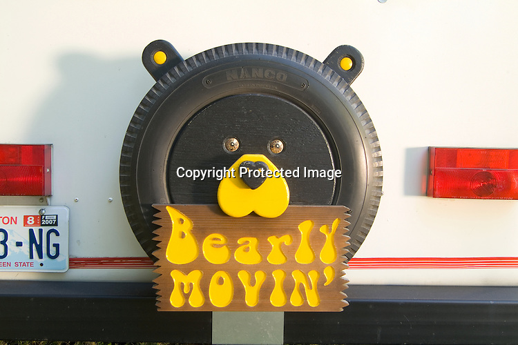 "Sign on the rear of a 1978 Fiber Stream vintage travel trailer that reads ""Bearly Movin'."""