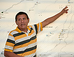 Clovis Marubo, 53, one of the early leaders in the Javari Valley Indigenous Territory, points to a map of the region in his office in Atalaia do Norte, Brazil, where he is also active in the local Catholic parish.