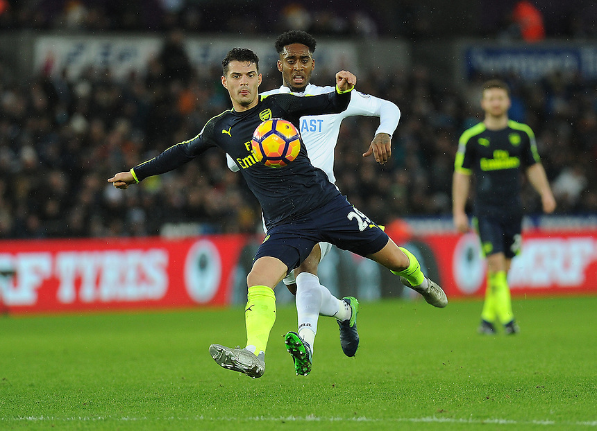 Arsenal's Granit Xhaka in action<br /> <br /> Photographer /Ashley Crowden CameraSport<br /> <br /> The Premier League - Swansea City v Arsenal  - Saturday 14th January 2017 - Liberty Stadium - Swansea <br /> <br /> World Copyright &copy; 2017 CameraSport. All rights reserved. 43 Linden Ave. Countesthorpe. Leicester. England. LE8 5PG - Tel: +44 (0) 116 277 4147 - admin@camerasport.com - www.camerasport.com