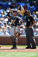 Milwaukee Brewers catcher Jonathan Lucroy (20) and umpire Tim Timmons during a game against the Chicago Cubs on August 14, 2014 at Wrigley Field in Chicago, Illinois.  Milwaukee defeated Chicago 6-2.  (Mike Janes/Four Seam Images)