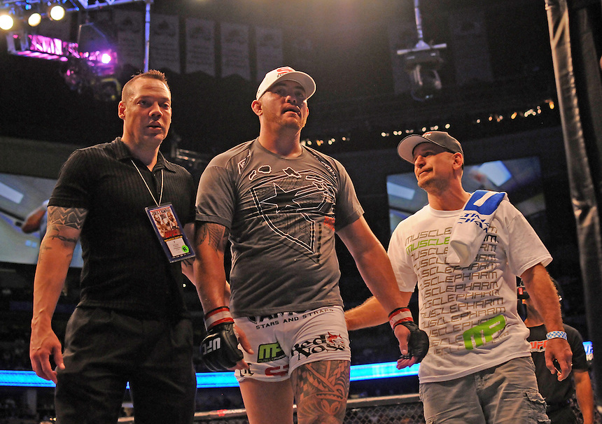 24 SEPTEMBER 2011:   Travis Browne steps out of the ring wth his trainers after beating Rob Broughton  during UFC 135 at the Pepsi Center in Denver, Colorado. *****For Editorial Use Only*****