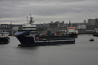 Oil Supply ship Troms Capellla leaving Aberdeen harbour and being guided by the Pilot ship Sea Haven.