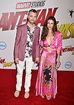 HOLLYWOOD, CA - JUNE 25: Sean Gunn (L) and Natasha Halevi arrive at the Premiere Of Disney And Marvel's 'Ant-Man And The Wasp' at the El Capitan Theatre on June 25, 2018 in Hollywood, California.
