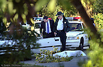 HILLSBOROUGH,TAMPA,1/23/04--FOR METRO STORY BY SHAW SLUGGED: SHOOTING--Officials work the scene of a fatal shooting involving Hillsborough County Sheriff's Office and a bank robbery suspect on Memorial Blvd. south of Hillsborough Avenue. One person was dead at the scene. (staff/Jay Nolan)