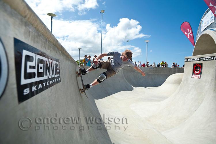 Man riding skateboard at skate park.  Cairns, Queensland, Australia