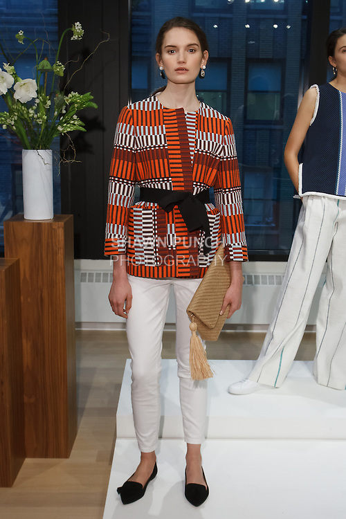 Model poses in an out Ann Taylor Spring Summer 2017 collection by Austyn Zung, at the Ann Taylor showroom in 7 Times Square, New York on October 26, 2016.