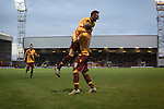Motherwell 3 Dundee 1, 12/12/2015. Fir Park, Scottish Premiership. Home forward Louis Moult leaping in celebration after scoring with a header to put his team two-nil ahead in the first-half as Motherwell (in amber) play Dundee in a Scottish Premiership fixture at Fir Park. Formed in 1886, the  home side has played at Fir Park since 1895. Motherwell won the match by three goals to one, watched by a crowd of 3512 spectators. Photo by Colin McPherson.