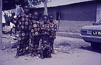 Toro College. Five children outside in colorful party clothes. Car - Toro .<br />  between 1970 and 1973