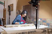 Am Museumsstandort Dahlem werden ca.  20.000 Objekte des Ethnologischen Museums und des Museums fuer Asiatische Kunst fur den Umzug in das Humboldt Forum vorbereitet.<br /> Im Bild: Restaurierung von Wandgemaelden von der noerdlichen Seidenstrasse aus der Oase von Kizil.<br /> 4.7.2019, Berlin<br /> Copyright: Christian-Ditsch.de<br /> [Inhaltsveraendernde Manipulation des Fotos nur nach ausdruecklicher Genehmigung des Fotografen. Vereinbarungen ueber Abtretung von Persoenlichkeitsrechten/Model Release der abgebildeten Person/Personen liegen nicht vor. NO MODEL RELEASE! Nur fuer Redaktionelle Zwecke. Don't publish without copyright Christian-Ditsch.de, Veroeffentlichung nur mit Fotografennennung, sowie gegen Honorar, MwSt. und Beleg. Konto: I N G - D i B a, IBAN DE58500105175400192269, BIC INGDDEFFXXX, Kontakt: post@christian-ditsch.de<br /> Bei der Bearbeitung der Dateiinformationen darf die Urheberkennzeichnung in den EXIF- und  IPTC-Daten nicht entfernt werden, diese sind in digitalen Medien nach §95c UrhG rechtlich geschuetzt. Der Urhebervermerk wird gemaess §13 UrhG verlangt.]