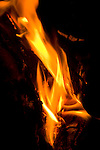 Camp fire flames and hot embers, close-up