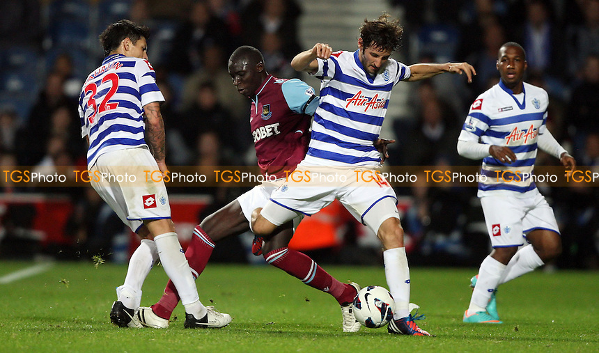 Mo Diame of West Ham challenges QPR pair Alejandro Faurlin and Esteban Granero - Queens Park Rangers vs West Ham United - Barclays Premier League at Loftus Road, London - 01/10/12 - MANDATORY CREDIT: Rob Newell/TGSPHOTO - Self billing applies where appropriate - 0845 094 6026 - contact@tgsphoto.co.uk - NO UNPAID USE.