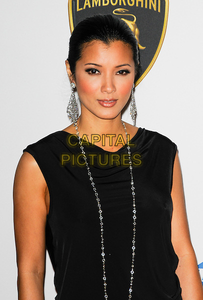KELLY HU .Arriving at The 17th Annual Race to Erase MS at the Hyatt Regency Century Plaza Hotel in Century City, California, USA, May 7th, 2010..half dangly earrings length black sleeveless dress necklace  silver .CAP/ROT.©Lee Roth/Capital Pictures