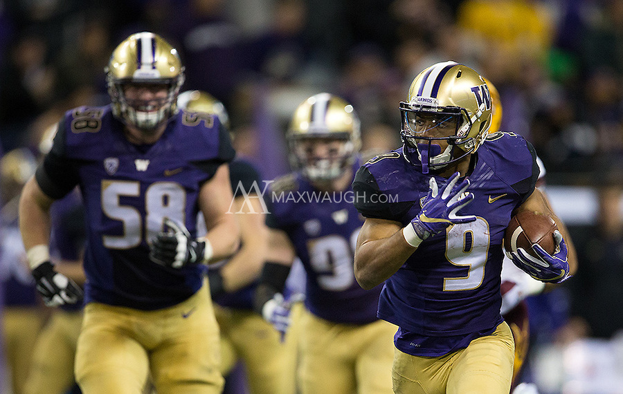 Myles Gaskin is off to the races and Kaleb McGary (58) is smiling about it.