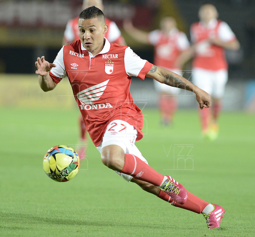BOGOTÁ -COLOMBIA, 24-01-2014. Luis Carlos Arias jugador de Santa Fe enacción durante el encuentro entre Independiente Santa Fe e Itaguí por la fecha 1 Liga Postobón  I 2014 disputado en el estadio el Campín de la ciudad de Bogotá./ Luis Carlos Arias player of Santa Fe in action during a match between Independiente Santa Fe and Itagui for the first date for the Postobon  League I 2014 played at El Campin stadium in Bogotá city. Photo: VizzorImage/ Gabriel Aponte / Staff