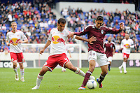 Rafa Marquez (4) of the New York Red Bulls and Tony Cascio (32) of the Colorado Rapids battle for the ball. The New York Red Bulls defeated the Colorado Rapids 4-1 during a Major League Soccer (MLS) match at Red Bull Arena in Harrison, NJ, on March 25, 2012.