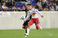 Connor Chinn (25) of the New York Red Bulls is chased by Shea Salinas (11) of the Philadelphia Union. The New York Red Bulls defeated the Philadelphia Union 2-1 during a US Open Cup qualifier at Red Bull Arena in Harrison, NJ, on April 27, 2010.
