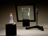 ILLUSION OF CANDLE BURNING UNDERWATER<br /> (Variations Available)<br /> Reflection of Candle Lost When Glass Is Tilted<br /> <br /> At a different angle to the viewer, the pane of glass no longer acts as a mirror.