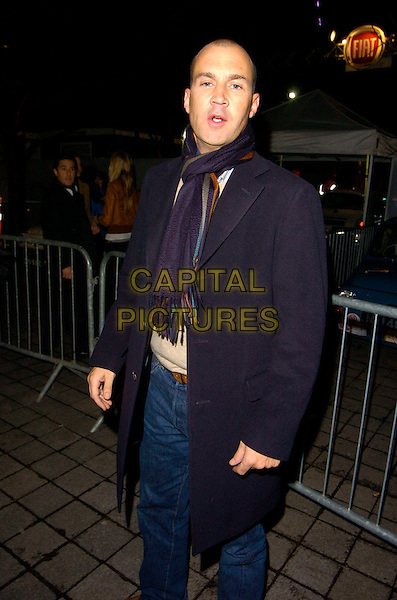 JOHNNY VAUGHAN.Leaving the Fiat 500 Launch Party, BA London Eye, Southbank, London, England, January 21st 2007..half length shaved head blue scarf coat jeans Vaughn.CAP/CAN.©Can Nguyen/Capital Pictures