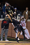 Essang Bassey (21) of the Wake Forest Demon Deacons intercepts a pass intended for Jakobi Meyers (11) of the North Carolina State Wolfpack late in the fourth quarter at BB&T Field on November 18, 2017 in Winston-Salem, North Carolina.  The Demon Deacons defeated the Wolfpack 30-24.  (Brian Westerholt/Sports On Film)