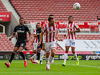 27th June 2020; Bet365 Stadium, Stoke, Staffordshire, England; English Championship Football, Stoke City versus Middlesbrough; Sam Vokes of Stoke City heads the ball clear from his box