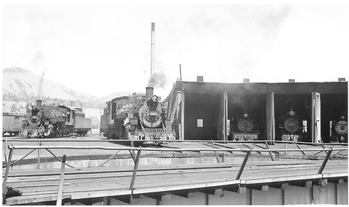 D&amp;RGW #480 &amp; #482 beside Durango roundhouse while #463, RGS #74 and unknown are in Durango roundhouse.<br /> D&amp;RGW, RGS  Durango, CO  Taken by Hilner, Ray C.