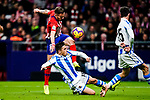 Saul Niguez of Atletico de Madrid (L) attempts a kick while being defended by Andoni Gorosabel of Real Sociedad (R) during the La Liga 2018-19 match between Atletico de Madrid and Real Sociedad at Wanda Metropolitano on October 27 2018 in Madrid, Spain.  Photo by Diego Souto / Power Sport Images
