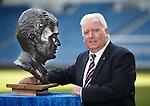 Alex MacDonald at Ibrox Stadium as he checks out the remarkable bronze bust of Rangers legend Sandy Jardine by artist Helen Runciman