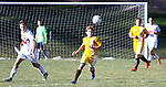 TERRYVILLE CT. 17 October 2017-101717SV08-#3 Chet Piece of Thomaston tries to get a ball down field against Terryville during soccer action in Terryville Wednesday. #23 Jack Smith of Terryville defends at left. <br /> Steven Valenti Republican-American