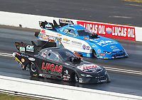 Sep 4, 2017; Clermont, IN, USA; NHRA funny car driver Del Worsham (near) races alongside John Force during the US Nationals at Lucas Oil Raceway. Mandatory Credit: Mark J. Rebilas-USA TODAY Sports