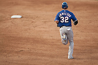 "Texas Rangers center fielder Josh Hamilton #32 trots around the bases after his first home run of the spring during the MLB exhibition baseball game against the ""AAA"" Round Rock Express on April 2, 2012 at the Dell Diamond in Round Rock, Texas. The Rangers out-slugged the Express 10-8. (Andrew Woolley / Four Seam Images)."