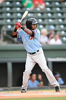 Shortstop Yonny Hernandez (1) of the Hickory Crawdads at bat during a game against the Greenville Drive on Monday, August 20, 2018, at Fluor Field at the West End in Greenville, South Carolina. Hickory won, 11-2. (Tom Priddy/Four Seam Images)