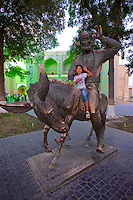 Uzbekistan, Bukhara.<br /> Lyabi-Hauz. Little girl sitting on the Caravan Monument.