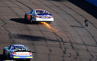 Nov. 8, 2008; Avondale, AZ, USA; NASCAR Nationwide Series driver David Reutimann loses a tire during the Hefty Odor Block 200 at Phoenix International Raceway. Mandatory Credit: Mark J. Rebilas-