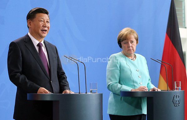 German chancellor Angela Merkel (CDU) and the Chinese president Xi Jinping deliver a joint statement in the chancellery in Berlin, Germany, 5 July 2017. The Chinese president is visiting Berlin ahead of the G20 summit in Hamburg (7-8 July 2017). Photo: Wolfgang Kumm/dpa /MediaPunch ***FOR USA ONLY***