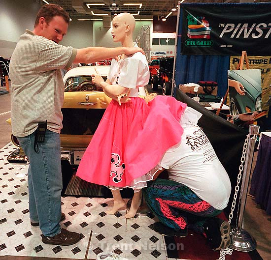 Ryan Galbraith and Don Brouse sets up a mannequin next to his '57 Thunderbird at the 24th annual Parts Plus Autorama, held at the Salt Palace Convention Center.<br />